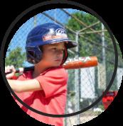 A child preparing to swing a baseball bat.